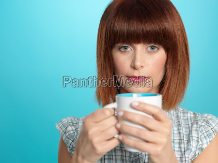 attractive young woman drinking her morning