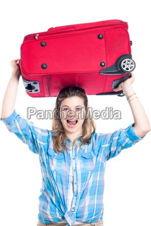 glueckliche reisende frau mit gepaeck