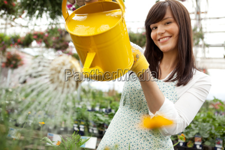 attractive female watering plants