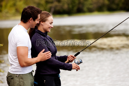 happy fishing woman