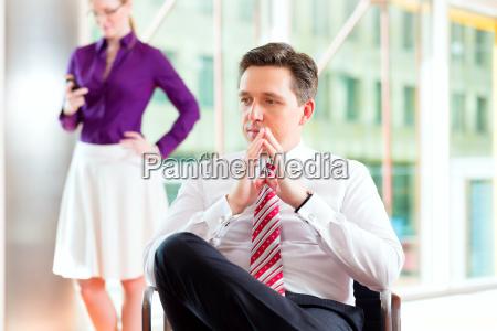 business chef und sekretaerin in