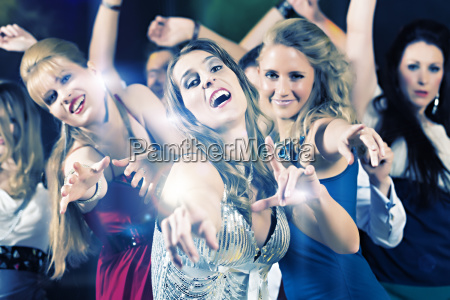 people dancing in club or disco