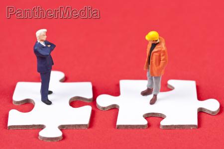 arbeitgeber und arbeitnehmer auf puzzle