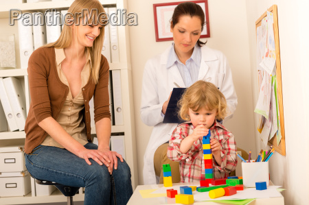 pediatrician mother daughter playing at office