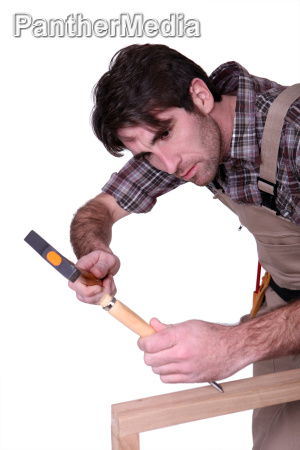craftsman working on a wooden board