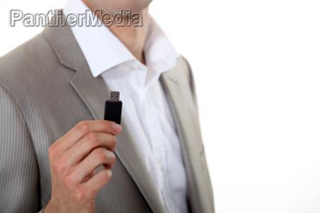 businessman holding usb key