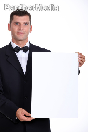 man wearing bow tie holding white