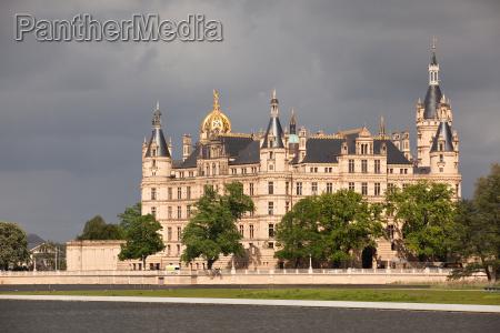 schwerin castle under dark clouds
