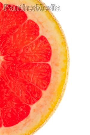 makroaufnahme einer halben grapefruitscheibe