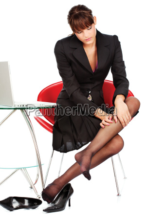 business woman relaxing her leg with