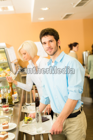 business colleagues at cafeteria with serving