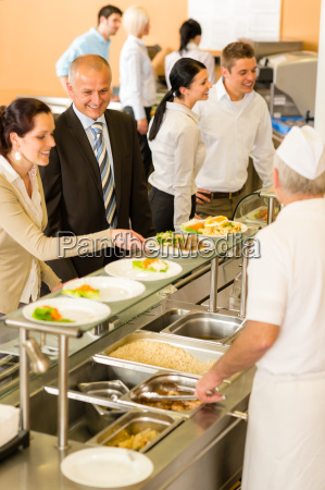 business colleagues cook serve lunch canteen