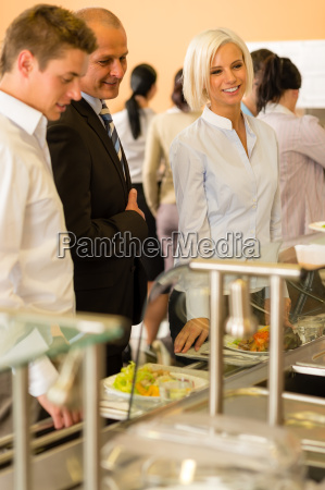 young business colleagues queue canteen lunch