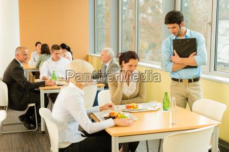 lunch break office colleagues eat salad
