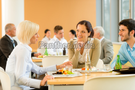cafeteria lunch young business people eat
