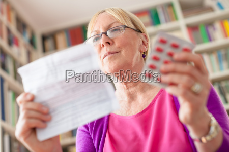 senior woman with medication pills and