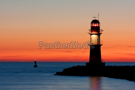 lighthouse at sunset at the harbor