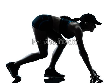 frau laeufer jogger auf dem startblock