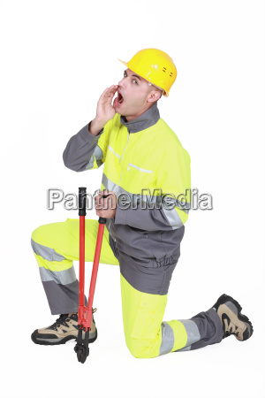 builder with bolt cutter shouting