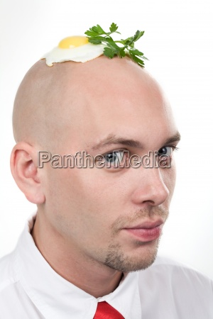 man with fried egg