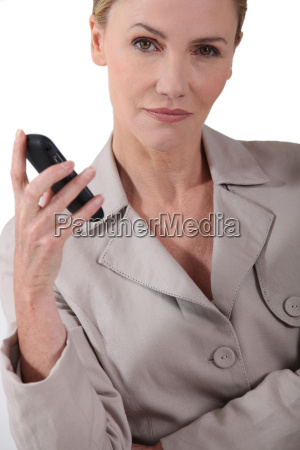 serious woman holding a mobile phone