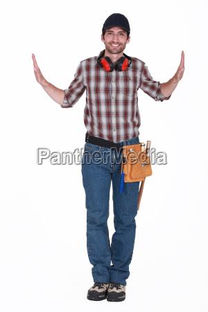 portrait of handsome carpenter wearing cap