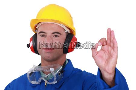 tradesman giving the a ok sign