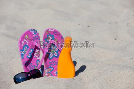 flip flops stuck in the sand