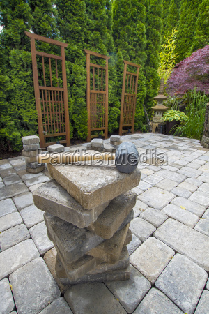 stack of pavers on backyard garden