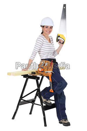 female carpenter with a saw