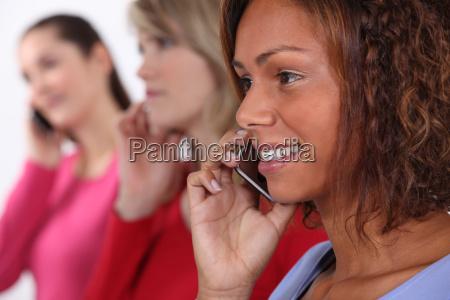 young women using cellphones