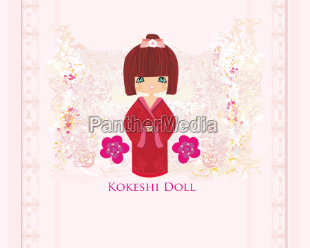 kokeshi doll on the pink background