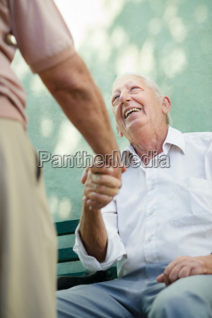 group of happy elderly men laughing