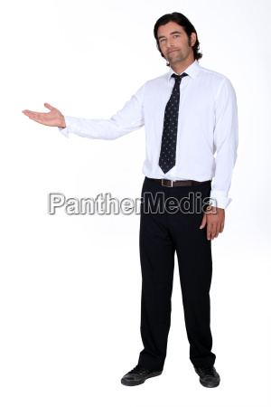 businessman holding his hand out into