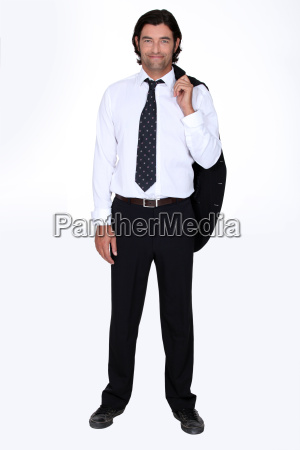 man holding his suit jacket over