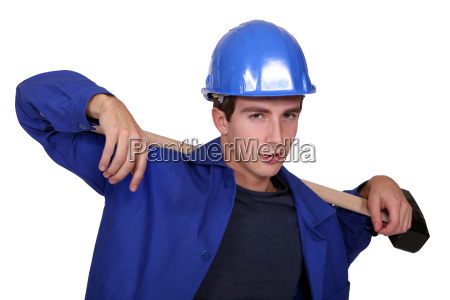 worker carrying a piece of wood