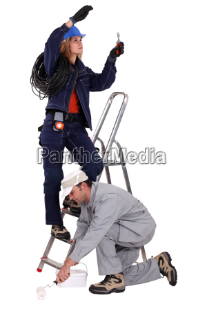 electrician on a ladder and painter