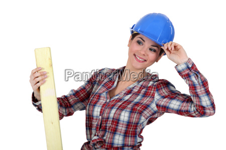 woman with plank of wood