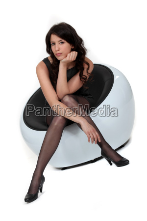 attractive woman sitting on a modern