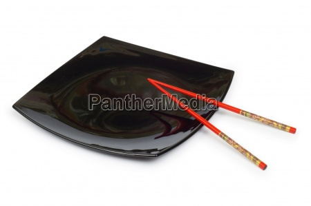 black plate and chopsticks isolated on