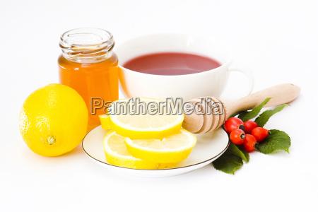 tasse tee mit honig und zitrone