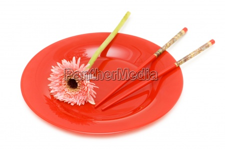 red flower and plate with chopsticks
