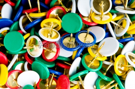 many colourful office pins on the