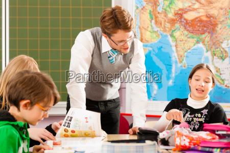 schoolchildren and teachers learn at school