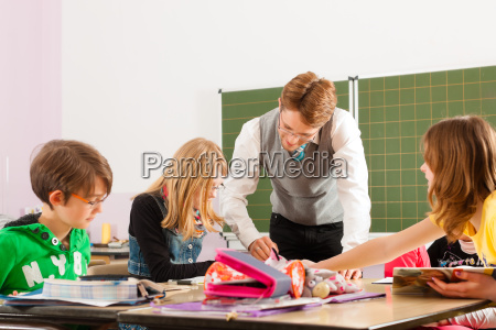 schoolchildren and teacher learning at school