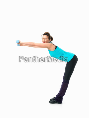 young woman showing fitness routine white