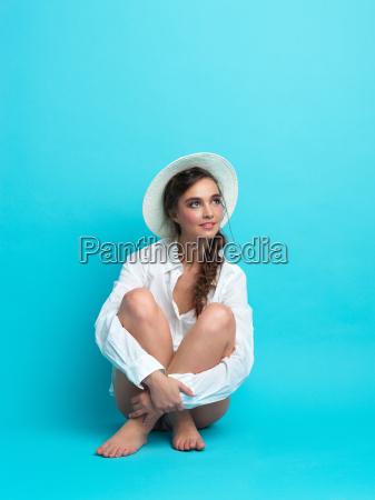 studio fashion portrait young woman blue
