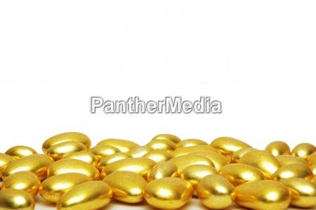 goldene formen auf dem weissen hintergrund
