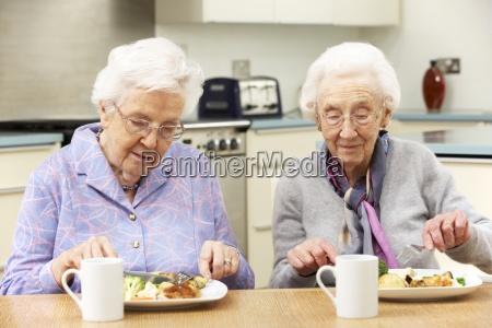 senior women enjoying meal together at
