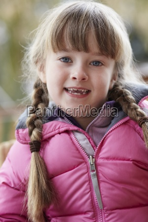 outdoor portrait of young girl wearing